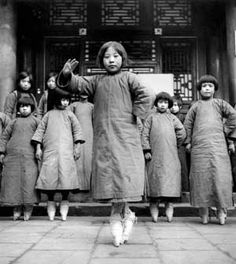Young 'sing-song' girls of about 8 or 10 years old, in training at a teahouse to entertain men during dinnerparties with singing, dance and recitations, China (1931-1934) - Ellen Thorbecke
