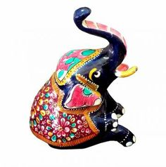 If you are looking for something unique for your living room or study, grab these superb elephant figurines. Made of  metal, the elephant is  in blue, orange, red and green colors. artisans have taken care of all the intricate details of this statue and have enhanced the features using colorful paints. The statue has a superior polish. Makes unique gifts for any occasion.