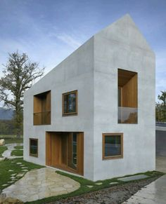 Cubo de concreto con sustracciones de madera