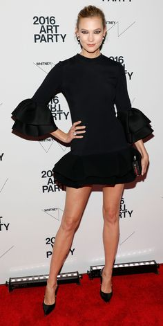 Karlie Kloss took her co-hosting duties seriously at the Annual Whitney Art Party, which showed through her dress of choice: a black ruffle-hem mini dress, a creation by Brandon Maxwell, that she styled with Swarovski jewelry.