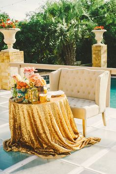 glitzy poolside sweetheart table // photo by Connection Photo // http://ruffledblog.com/glittery-outer-banks-wedding