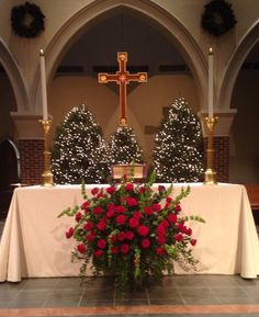2013 Christmas Altar flowers--roses, bells of Ireland and greens