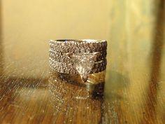 Trillion cut diamond engagement ring and wedding bands - I'm biased.