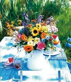 Rosen, Ringelblumen und Sonnenblumen