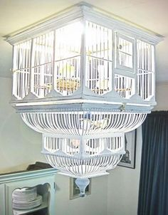 Recycle bird cage as a light fixture.