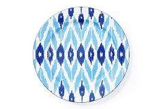An intricate ikat pattern is enlivened with clear and classic color on this graphic, gorgeous platter.