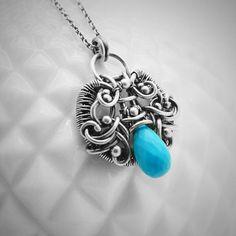This one of a kind necklace features a beautiful faceted teardrop briolette of turquoise, wire wrapped in oxidized sterling and fine silver. Turquoise is a symbol for friendship. - Sterling silver wire - Fine silver wire - Teardrop faceted turquoise - Length pendant: 1 1/8 (2.9cm)