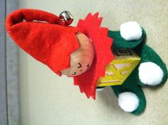 Christmas Elf.  Somebody gave this to me as a gift.   A little felt, an alphabet block, round piece of wood, some glue and paint.  So cute!  And so easy to make too.