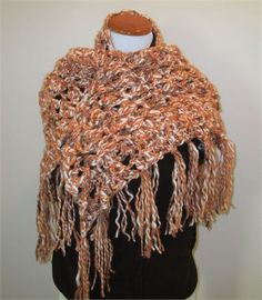 Striking warm chunky shawl wrap in rust (burnt orange), white, and brown. A wonderful blend of colors to wear with your wardrobe. Two strands of variegatedyarns are alternetelytwistedtogether in different tensions to create a unique look.   65 inches wide at longest side and 25 inches from top to point excluding trim.   Materials: Acrylic 70%, Wool 15 %, Polyester 15%.   Care Instructions: Hand wash, lay flat to dry.   Thank you for visiting y shop.