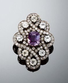 ALEXANDRITE BROOCH, LATE CENTURY Set at the center with a cushion-shaped Alexandrite weighing carats, within an interlacing surround of circular-cut diamonds and eight synthetic stones. Victorian Jewelry, Antique Jewelry, Vintage Jewelry, Art Deco Jewelry, Fine Jewelry, Jewelry Design, Craft Jewelry, Alexandrite Jewelry, Gemstone Jewelry