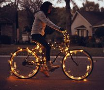 Inspiring picture bicycle, christmas lights, girl, house, lights. Resolution: 500x331 px. Find the picture to your taste!