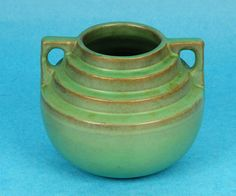 """CATALINA ISLAND ART POTTERY GREEN DOUBLE HANDLE STEP DESIGN VASE sold for $410 on ebay after 16 bids 6/2013.  Marked """"Catalina""""."""