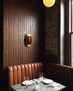 Leather banquette and beadboard