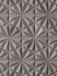 The texture of petals created by the tiles on this wall create a honeycomb like pattern that could cover a whole wall and not feel like too much