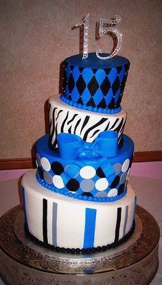 Whimsical Topsy Turvy Birthday Cake Has A Blue And Black Color Scheme