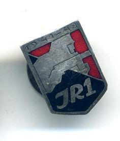A Finnish Infantry Regimental Belt Badge for JR 1. The badge is in black and red…