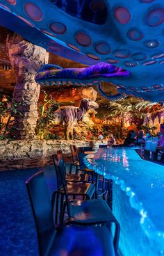 T-Rex Cafe is a dinosaur-themed table service restaurant in Disney Springs at Walt Disney World that is aimed primarily at families with small children. Disney World Food, Disney World Restaurants, Disney World Planning, Disney World Vacation, Disney World Resorts, Disney Vacations, Disney Trips, Disney Worlds, Disney Tourist Blog