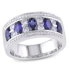 Oval Lab-Created Blue and White Sapphire with 1/8 CT. T.W. Diamond Ring in Sterling Silver