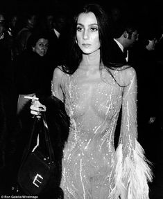 Cher wears a daring outfit designed by Bob Mackie to the 1974 MET gala