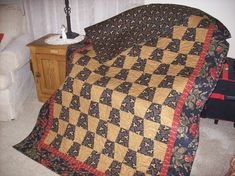 Tumbler Quilt.  I love the color of brown used in this quilt.  The border fabric is just a beautiful print.