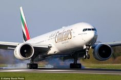 Emirates flight from Sao Paulo to Dubai forced to make emergency landing in Nigeria 'after drug smuggler who swallowed cocaine suffered seizures'
