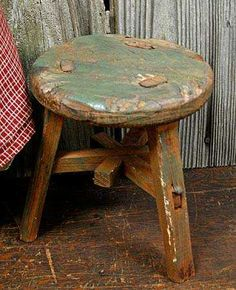 Use small milking stools to add height to vignettes
