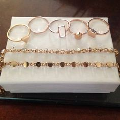 Gold ring and bracelet bundle Bundle of 2 gold colored bracelets and 5 geometric shaped rings.  The rings are quite small but the bracelets are a s/m. I'd say the rings around a size 5 and 6 or could be worn as midi rings! Jewelry Rings
