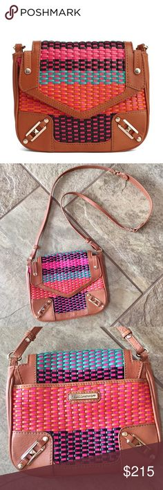 REBECCA MINKOFF May May Crossbody 🔷BUNDLE & SAVE 30%🔷 Multi-colored woven leather, front flap with magnetic closure, interior fabric is signature polka dot pattern, shiny gold hardware, has strap that is not adjustable, 1 slip pocket inside, outside pocket on the back has magnetic snap closure. LIKE-NEW 8in(L) 7in(H) 1in(W) strap drop 20.5in Rebecca Minkoff Bags Crossbody Bags