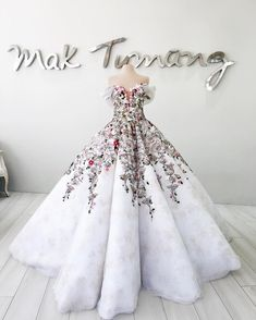 Daring wedding dress with tulle skirt and floral details // Filipino designer Mak Tumang studied interior design before delving into fashion in the Philippines. His love of opulent costumes and architecture influences his designs and this can be seen in his gowns which are rich in elaborate detail.