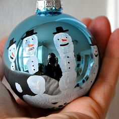 Paint a child's hand white and have them grab hold of a bulb. Make Snowmen from the fingers and write their name and date on their palm at the bottom. Very cool!