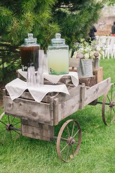 antique wagon offered iced tea and lemonade to ceremony guests / http://www.deerpearlflowers.com/wagon-wheelbarrow-country-wedding-ideas/