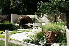 The Living Landscapes: City Twitchers Garden features a pond, complete with water lilies, a chamomile lawn and a stylish pod, woven from willow.  The pod also acts as bird hide and is designed to be the perfect place to relax and enjoy the birds and other wildlife in the garden.