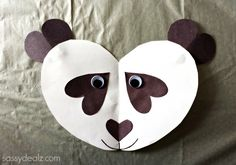 Learn how to make a panda bear out of paper hearts! All you need is paper, glue, scissors, googly eyes, and a marker. Fun and easy DIY art project for kids.
