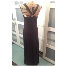 "NWT Michael Kors maxi dress size M Michael Kors NWT long chocolate colored maxi  that criss crosses on the back with a gold rim that has ""Michael Kors "" on it. Approx: 57 inches from top of shoulder. Approx;30 inch slit on one side. Michael Kors Dresses Maxi"