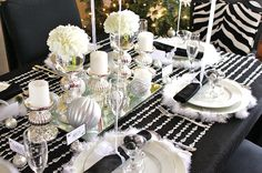 Black & White & Silver & Shimmer party theme: Table is topped with an acrylic beaded curtain which acts as a runner.  Mirrored centerpiece is filled with silver pillar candle holders, ornaments, & hydrangeas.