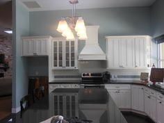 Craftsman White Cabinets with Black Granite Countertops