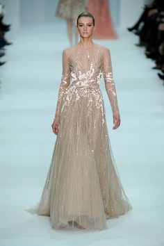 Sheer nude colored long sleeve dress with sequined and floral appliques.   Elie Saab Spring 2012 Couture Collection