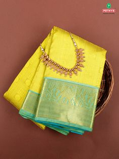 Bathe in the luxury of pure silk and pure zari with the brightness of yellow and elephant motif zari border on your special day. #Weddigsaree #silksaree #weddingblouse #Accessories #SareeBlouse #Sareeaccessories