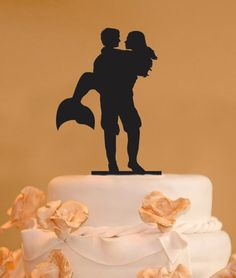 This Man holding a mermaid silhouette wedding cake topper is made from food safe acrylic and we have many colors to choose from. This cake