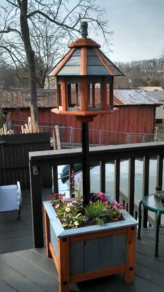 Wooden planter with bird feeder