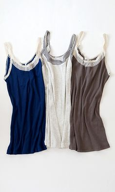 100% cotton lace-edged cami is perfect alone or peeking beneath a blouse or sweater.