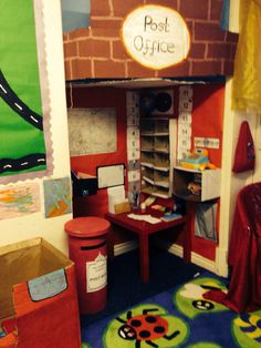 Thought: Cubicle walls (or using furniture) section long wall into squares to make our village, post office, salon, store, florist etc. Mini areas for 1-2 kiddos @ a time.