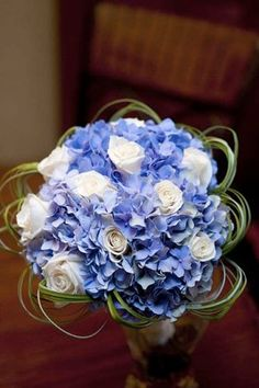 Blue Hydrangea and roses wedding flower bouquet, bridal bouquet, wedding flowers, add pic source on comment and we will update it. http://www.myfloweraffair.com can create this beautiful wedding flower look.