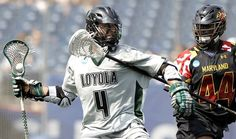 FOXBORO, MA - MAY 28:  Mike Sawyer #4 of the Loyola Greyhounds tries to fend off the stick of Goran Murray #44 of the Maryland Terripans during the second half of Loyola's 9-3 win in the 2012 NCAA Division I Men's Lacrosse Championship game at Gillette Stadium on May 28, 2012 in Foxboro, Massachusetts.  Gotta Love the determination on his face!!!