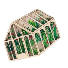 A visit to Kew in the height of summer inspired the creation of this layered wooden brooch. Hand painted tropical foliage grows wild within the walls of this wooden greenhouse. The design is laser cut and engraved from sustainably sourced plywood and carefully painted by hand, ensuring each is unique.