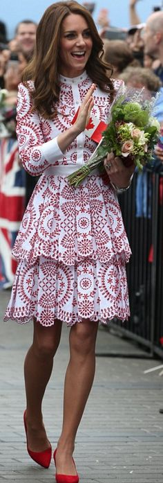 Kate Middleton: Purse – Miu Miu  Watch – Cartier  Dress – Alexander McQueen  Shoes -Gianvito Rossi