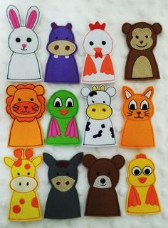These finger puppets are made with a felt. Great for entertaining the little ones and will provide hours of fun. Ideal for Making a Story, Show or reading along side a book. Suitable for quiet book, busy book or activity book. There are 12 finger puppet in this book. - Cow, Donkey, Chicken, Cat, Giraffe, Bear, Hippo, Lion, Duck, Bird, Monkey and Bunny. Measures: Hight: from 2 to 3 1/2 Materials: Felt Ready to ship.