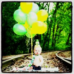 1st Birthday photo. Got the ballon idea off of here. Here is how his picture turned out. Picture taken by Crystal @ journey photography :)