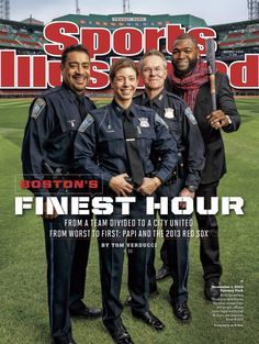 Boston police officers Javier Pagan and Rachel McGuire and detective Kevin McGill stand with David Ortiz on the Nov. 11