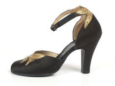Black satin ankle strap pumps with gold leather trim, USA, 1930's